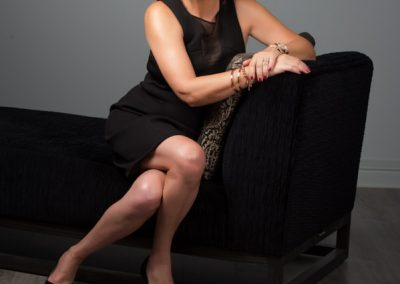 Desley sitting on lounge