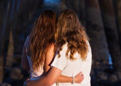 couple hugging under pier