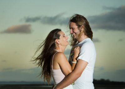 couple hugging in wind