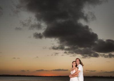 couple hugging in sunset
