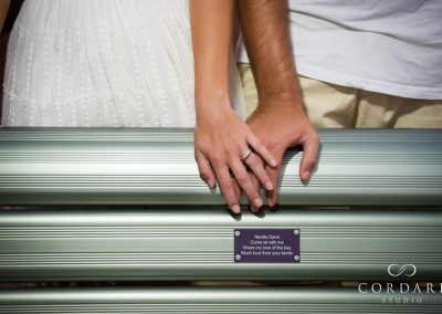 holding hands by commemorative plaque