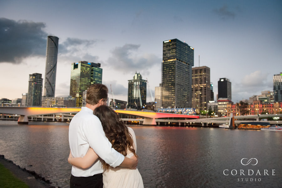 Couple hug by the Brisbane River