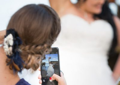 Guests taking photo of bride