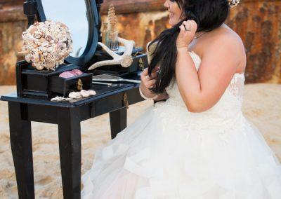 Bride brushing hair