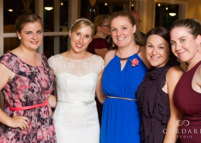 Bride with friends at reception
